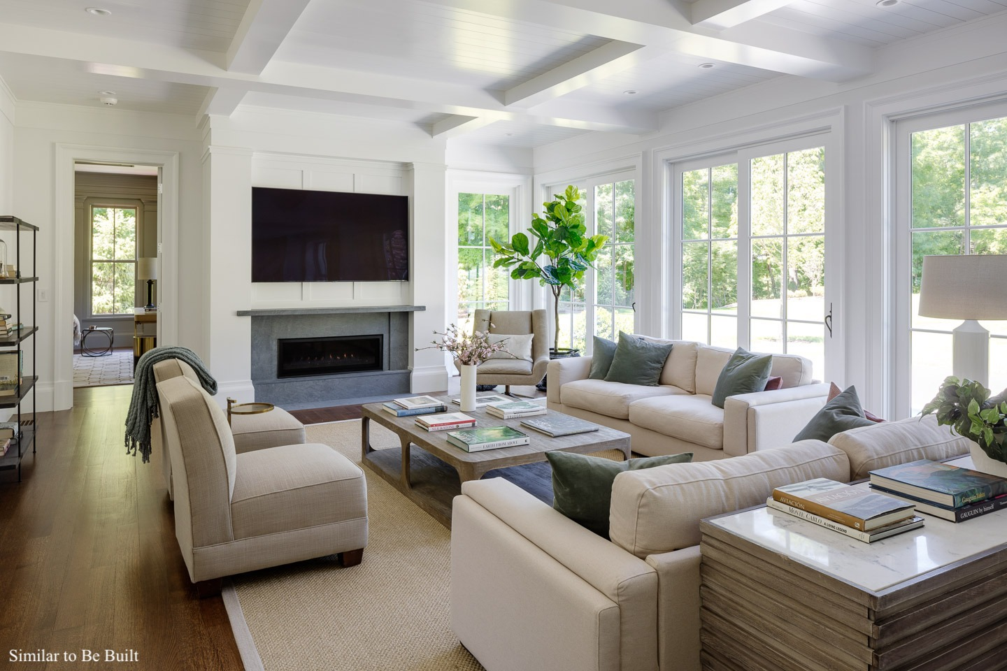Newly constructed Family room at 21 Chestnut Street with windows along the back wall